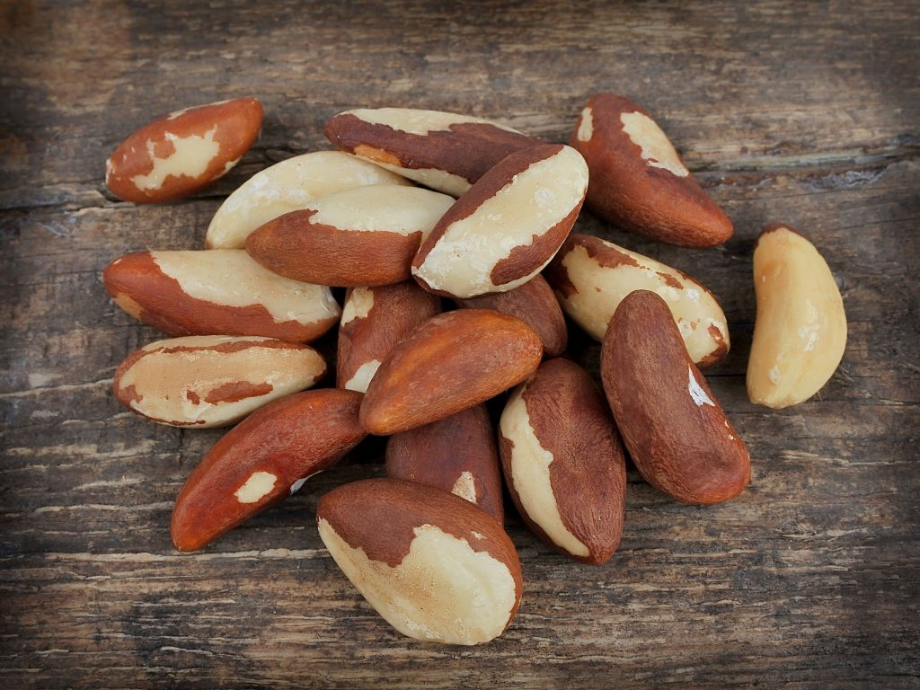 15845397 - bertholletia brazil nuts on wooden texture