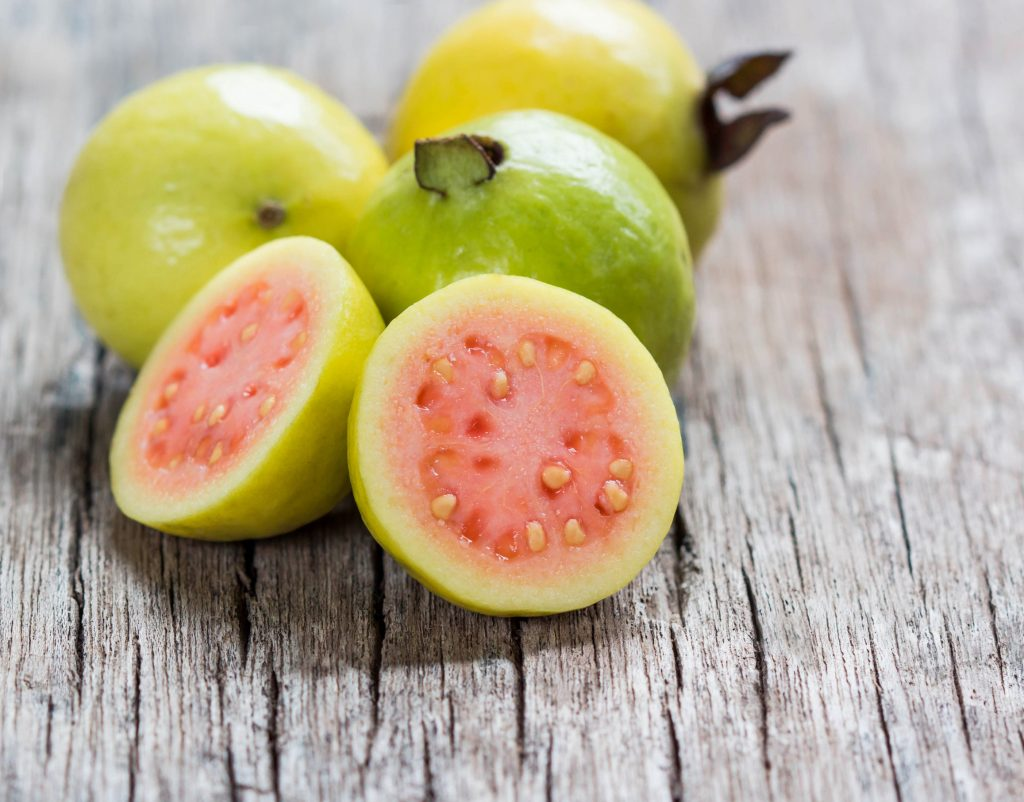 48174650 - fresh guava fruit on wooden table.